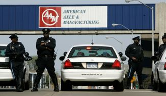 FILE - In this April 24, 2008, file photo, Detroit police officers block an entrance to the American Axle and Manufacturing Holdings plant in Detroit. Google's self-driving car spinoff Waymo says it will reopen an axle plant in Detroit to convert conventional vehicles so they can drive autonomously. The company says it will lease a now-closed American Axle & Manufacturing plant north of downtown so it can convert the vehicles, mostly Chrysler Pacifica minivans. (AP Photo/Carlos Osorio, File)