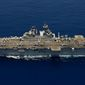 In this file photo, the amphibious assault ship USS Makin Island (LHD 8) conducts flight deck operations in the Indian Ocean. Officials with U.S. Africa Command (AFRICOM) said the Makin Island Amphibious Ready Group and 15th Marine Expeditionary Unit arrived in the Indian Ocean off Somalia's coast on Monday, Dec. 21, 2020.  (U.S. Navy photo by Chief Mass Communication Specialist John Lill/Released)  **FILE**