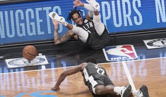 Brooklyn Nets guard D'Angelo Russell, top, and guard Caris LeVert (22) fall on the court during the second half of Game 4 of a first-round NBA basketball playoff series against the Philadelphia 76ers, Saturday, April 20, 2019, in New York. (AP Photo/Mary Altaffer)