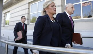 Bridget Anne Kelly, center, the former Deputy Chief of Staff for former New Jersey Gov. Chris Christie, walks with her lawyer Michael Critchley, right, and an associate while arriving at the Martin Luther King, Jr., Federal Courthouse for a re-sentencing hearing, Wednesday, April 24, 2019, in Newark, N.J. Kelly was convicted in 2016 in the alleged plot to cause traffic jams to punish a mayor for not endorsing Christie's re-election bid. (AP Photo/Julio Cortez)