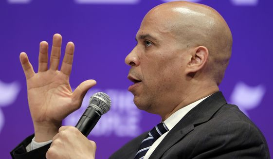 Democratic presidential candidate Sen. Cory Booker, D-N.J., answers questions during a presidential forum held by She The People on the Texas State University campus Wednesday, April 24, 2019, in Houston. (AP Photo/Michael Wyke) ** FILE **