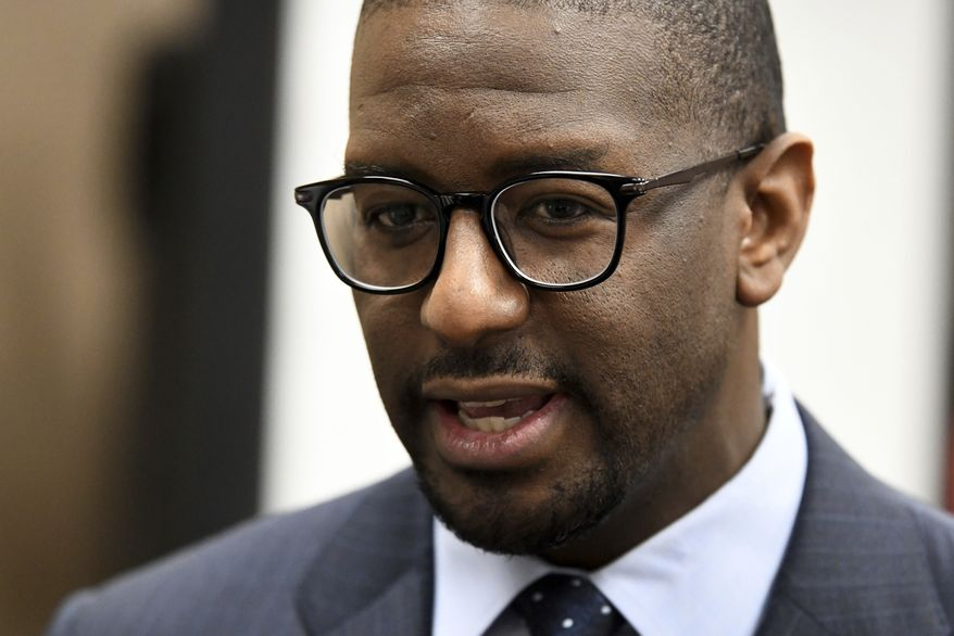 Former Mayor of Tallahassee Andrew Gillum addresses the media after it was announced that he settled in his case with the Florida Commission on Ethics Wednesday, April 24, 2019. Gillum settled with the Florida Commission on Ethics and agreed to pay a $5,000 fine to settle an ethics complaint that he violated civil law by accepting a gift from a lobbyist. The state Ethics Commission agreed to drop four additional counts of violations.  (Alicia Devine/Tallahassee Democrat via AP)