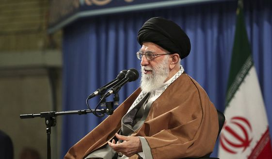 In this photo released by an official website of the office of the Iranian supreme leader, Supreme Leader Ayatollah Ali Khamenei speaks at a meeting in Tehran, Iran, Wednesday, April 24, 2019. Iranian leaders are defiant in the wake of President Donald Trump's decision to impose sanctions on countries that import Iranian oil, vowing to respond to America's move. (Office of the Iranian Supreme Leader via AP)