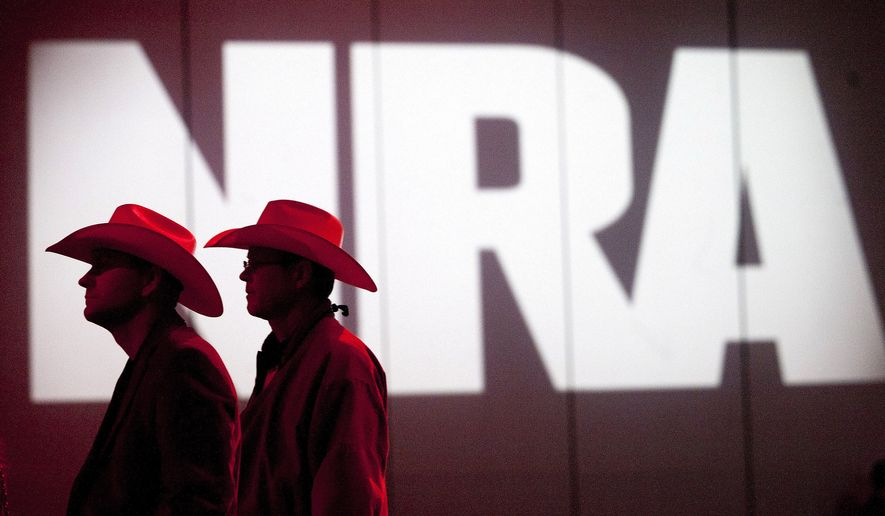 National Rifle Association members listen to speakers during the NRA's annual Meetings and Exhibits at the George R. Brown Convention Center in Houston. (Johnny Hanson/Houston Chronicle via AP, File)