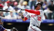 Washington Nationals' Juan Soto follows the flight of his two-run home run off Colorado Rockies starting pitcher German Marquez in the third inning of a baseball game Wednesday, April 24, 2019, in Denver. (AP Photo/David Zalubowski)
