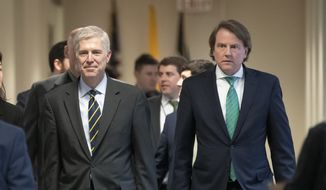 President Trump's White House counsel, Don McGahn, right, escorts Supreme Court nominee, Neil Gorsuch, left, on Capitol Hill in Washington, Monday, Feb. 6, 2017. McGahn, who sat with special counsel Robert Mueller for about 30 hours of interviews, has emerged as a central character in Mueller's painstaking investigation into whether Trump obstructed justice and impeded the years-long Russia investigation. (AP Photo/J. Scott Applewhite)