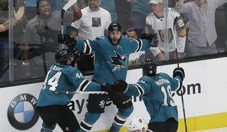San Jose Sharks right wing Barclay Goodrow, center, celebrates with defenseman Marc-Edouard Vlasic (44) and center Joe Thornton (19) after scoring the winning goal against the Vegas Golden Knights during overtime of Game 7 of an NHL hockey first-round playoff series in San Jose, Calif., Tuesday, April 23, 2019. (AP Photo/Jeff Chiu)