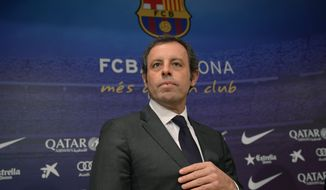 FILE - In this Thursday, Jan 23, 2014 file photo, FC Barcelona's president Sandro Rosell attends a press conference at the Camp Nou stadium in Barcelona, Spain. Former Barcelona president Sandro Rosell has been acquitted of money laundering charges after spending nearly two years in prison. (AP Photo/Manu Fernandez, File)