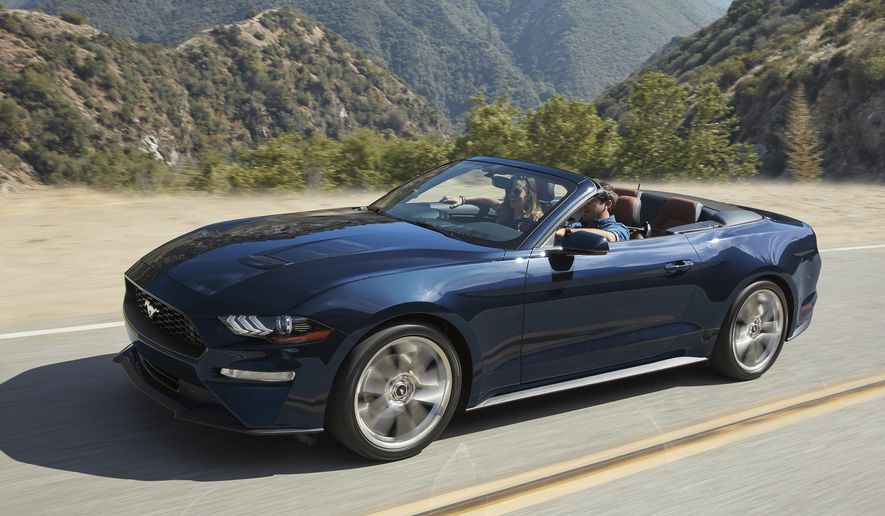 This undated photo provided by Ford Motor Co. shows the 2019 Ford Mustang, a modern interpretation of the classic pony car. A Performance package that makes the Mustang feel sportier is available if you opt for the powerful V8. (Courtesy of Ford Motor Co. via AP)
