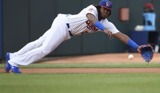 In this Tuesday, July 31, 2018, photo, Buffalo Bisons third baseman Vladimir Guerrero Jr. dives for the ball on a single by Lehigh Valley IronPigs' Aaron Altherr during first inning of a Triple-A minor league baseball game in Buffalo, N.Y. The Toronto Blue Jays will promote top prospect Vladimir Guerrero Jr. before their game against the Oakland Athletics, on Friday, April 26. (Nathan Denette/The Canadian Press via AP)