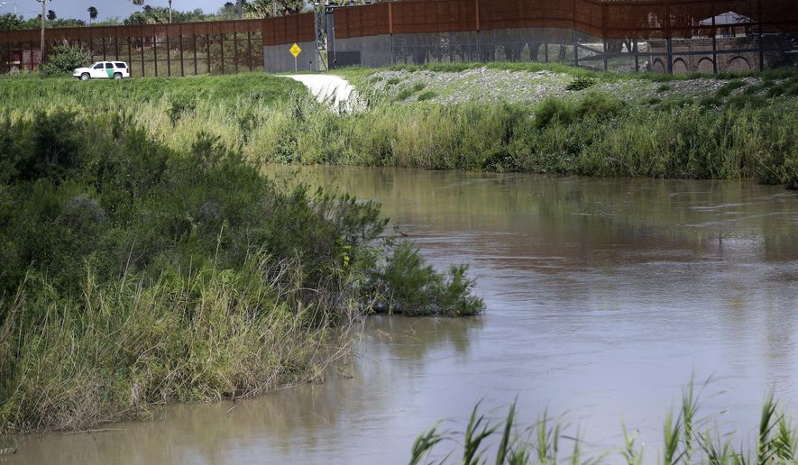 In this June 26, 2018, file photo, a U.S. Border Patrol vehicle sits above the Rio Grande River at the U.S. - Mexico border in Brownsville, Texas. U.S. Border Patrol agents found a 3-year-old boy alone in a field after likely being abandoned by smugglers at the southern border, authorities said. U.S. Customs and Border Protection said late Tuesday, April 23, 2019, that the boy's name and phone numbers were written on his shoes when agents found him that morning. The agency said it is trying to reach the boy's family. (AP Photo/David J. Phillip, File) **FILE**