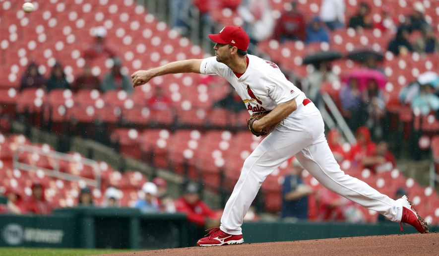 2d2521a9af8 St. Louis Cardinals starting pitcher Adam Wainwright throws during the  first inning of a baseball