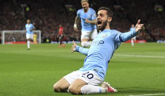 Manchester City's Bernardo Silva celebrates after scoring the opening goal during the English Premier League soccer match between Manchester United and Manchester City at Old Trafford Stadium in Manchester, England, Wednesday April 24, 2019. (AP Photo/Jon Super)