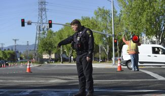 Police and road crews work the scene after a car crash at the intersection of El Camino Real and Sunnyvale Road in Sunnyvale, Calif., on Wednesday, April 24, 2019. Investigators are working to determine the cause of the crash in Northern California that injured several pedestrians on Tuesday evening. Authorities say the driver of the car was taken into custody after he appeared to deliberately plow into the group. (AP Photo/Cody Glenn)