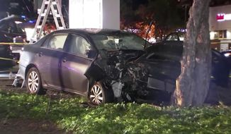This April 23, 2019,  image from video provided by KGO-TV, shows the scene of a car crash where several pedestrians were struck and injured in Sunnyvale, Calif. The FBI says it's assisting California officials in the investigation of a motorist who appeared to deliberately plow into the group of people. (KGO-TV via AP)