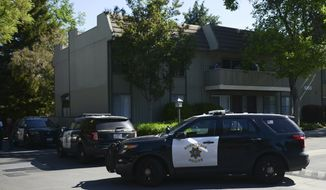 Police vehicles surround the apartment complex believed to be associated with a car crash suspect in Sunnyvale, Calif., Wednesday, April 24, 2019. A witness to a California crash that injured eight people said Wednesday he was waiting for a traffic light to turn green when a Toyota Corolla plowed through the intersection at a high speed, sending pedestrians flying into the air in the Silicon Valley city of Sunnyvale. (AP Photo/Cody Glenn)