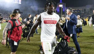 FILE - In this Nov. 19, 2018, file photo, Kansas City Chiefs wide receiver Tyreek Hill walks off the field after an NFL football game against the Los Angeles Rams, in Los Angeles. The Kansas City Chiefs have made a habit of inciting controversy during the NFL draft in the Andy Reid era by acquiring players that have a history of off-the-field issues. The team took a chance on cornerback Marcus Peters, who was traded away after getting into trouble with coaches. It drafted running back Kareem Hunt, then quickly cut him when he kicked a woman in a hotel hallway. And it picked wide receiver Tyreek Hill, who is currently dealing with a domestic violence case that centers on the 3-year-old child he shares with his fiance.(AP Photo/Kelvin Kuo, File)