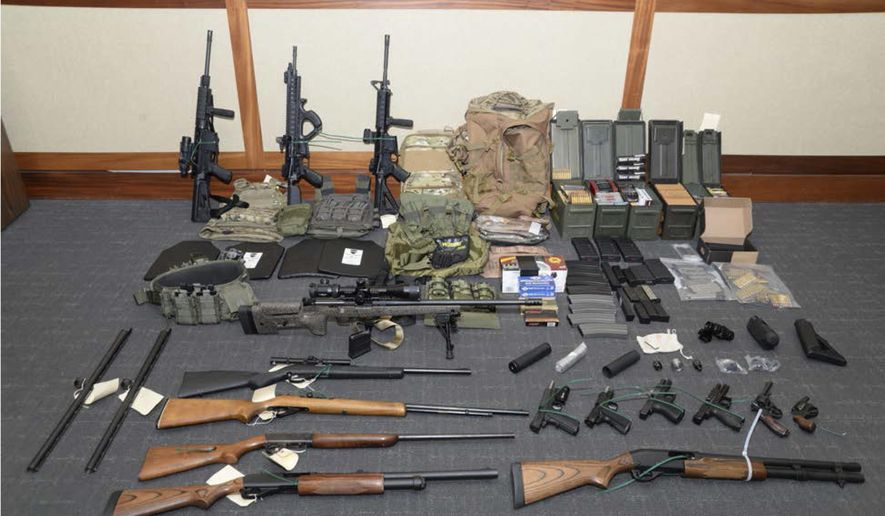 This file image provided by the U.S. District Court in Maryland shows a photo of firearms and ammunition that was in the motion for detention pending trial in the case against Christopher Paul Hasson. Hasson, a Coast Guard lieutenant accused of stockpiling guns and compiling a hit list of prominent Democrats and network TV journalists looked at other targets: two Supreme Court justices and two executives of social media companies, according to federal prosecutors in a court filing Tuesday, April 22, 2019. (U.S. District Court via AP) **FILE**