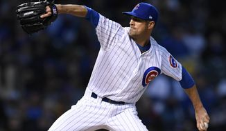 Chicago Cubs starter Cole Hamels delivers a pitch during the first inning of a baseball game against The Los Angeles Dodgers Wednesday, April 24, 2019, in Chicago. (AP Photo/Paul Beaty)