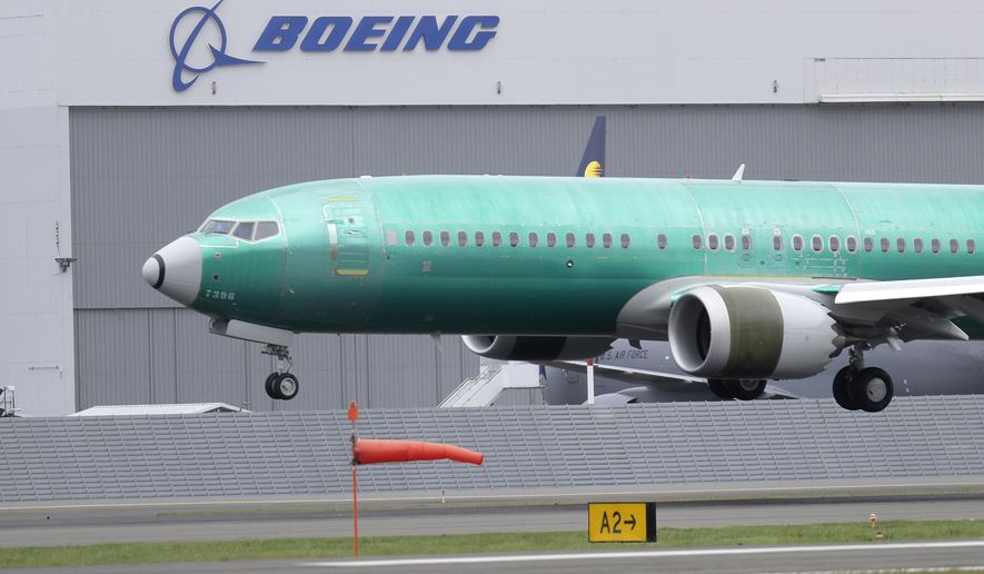 In this April 10, 2019, file photo a Boeing 737 MAX 8 airplane being built for India-based Jet Airways lands following a test flight at Boeing Field in Seattle. Boeing Co. reports earnings Wednesday, April 24. (AP Photo/Ted S. Warren, File)
