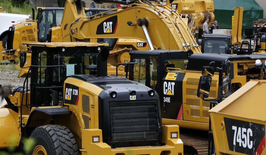 FILE - In this July 25, 2017, file photo Caterpillar machinery sits at a dealership in Murrysville, Pa. Caterpillar Inc. reports earnings Wednesday, April 24, 2019. (AP Photo/Gene J. Puskar, File)