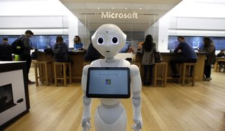 "FILE - In this March 21, 2019, file photo a robot called ""Pepper"" is positioned near an entrance to a Microsoft Store location, in Boston. Microsoft Corp. reports earnings Wednesday, April 24. (AP Photo/Steven Senne, File)"