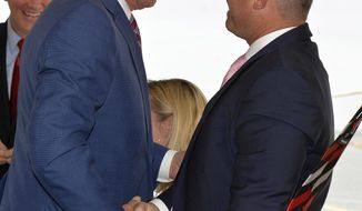 Governor Brian Kemp, left, shakes the hand of Ray Hufnagel, Plastic Express President and CEO following a ceremony Wednesday, April 24, 2019 announcing that Plastic Express will expand operations and invest more than $172 million at the Port Logistics Center in Pooler. (Steve Bisson/Savannah Morning News via AP)
