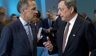European Central Bank (ECB) President Mario Draghi, right speaks with Bank of England Governor Mark Carney as they attends the International Monetary and Financial Committee (IMFC) conference, at the World Bank/IMF Spring Meetings in Washington, Saturday, April 13, 2019. (AP Photo/Jose Luis Magana)