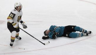 San Jose Sharks center Joe Pavelski, right, lies on the ice next to Vegas Golden Knights center Cody Eakin during the third period of Game 7 of an NHL hockey first-round playoff series in San Jose, Calif., Tuesday, April 23, 2019. (AP Photo/Jeff Chiu)