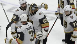 Vegas Golden Knights goaltender Marc-Andre Fleury (29) reacts with right wing Alex Tuch (89), defenseman Brayden McNabb (3) and center William Karlsson (71) after losing to the San Jose Sharks during overtime of Game 7 of an NHL hockey first-round playoff series in San Jose, Calif., Tuesday, April 23, 2019. (AP Photo/Jeff Chiu)