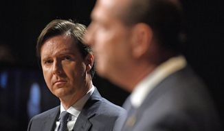 Former state Auditor Adam Edelen, left, listens as Kentucky state Rep. Rocky Adkins, D-Sandy Hook, responds during a Democratic gubernatorial debate at Transylvania University in Lexington, Ky., Wednesday, April 24, 2019. (AP Photo/Timothy D. Easley)