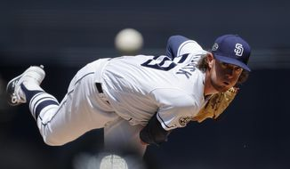 San Diego Padres starting pitcher Chris Paddack works against a Seattle Mariners batter during the first inning of a baseball game Wednesday, April 24, 2019, in San Diego. (AP Photo/Gregory Bull)