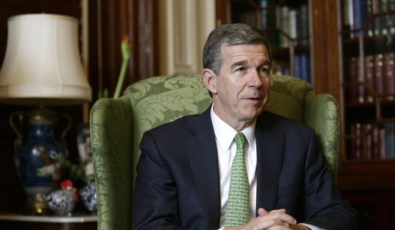 In this Wednesday, Dec. 19, 2018, file photo, North Carolina Gov. Roy Cooper speaks to The Associated Press during an interview at the Governor's mansion in Raleigh, N.C. (AP Photo/Gerry Broome, File) ** FILE**