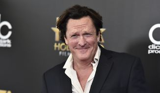 FILE - In this Nov. 1, 2015 file photo, Michael Madsen arrives at the Hollywood Film Awards at the Beverly Hilton Hotel in Beverly Hills, Calif. Prosecutors have charged Madsen with two misdemeanor counts of drunken driving after the actor drove his SUV into a pole on March 24, 2019. Madsen has not entered a plea, and is scheduled to appear in court May 20. (Photo by Jordan Strauss/Invision/AP, File)
