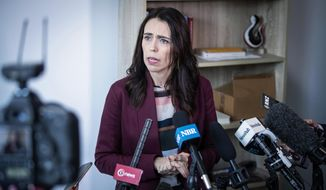 New Zealand Prime Minister Jacinda Ardern speaks to media at her electorate office in Aukland, Wednesday, April 24, 2019. Ardern said that she and French President Emmanuel Macron will host a meeting in Paris next month seeking to eliminate acts of violent extremism and terrorism from being shown online. (Jason Oxenham/New Zealand Herald via AP)