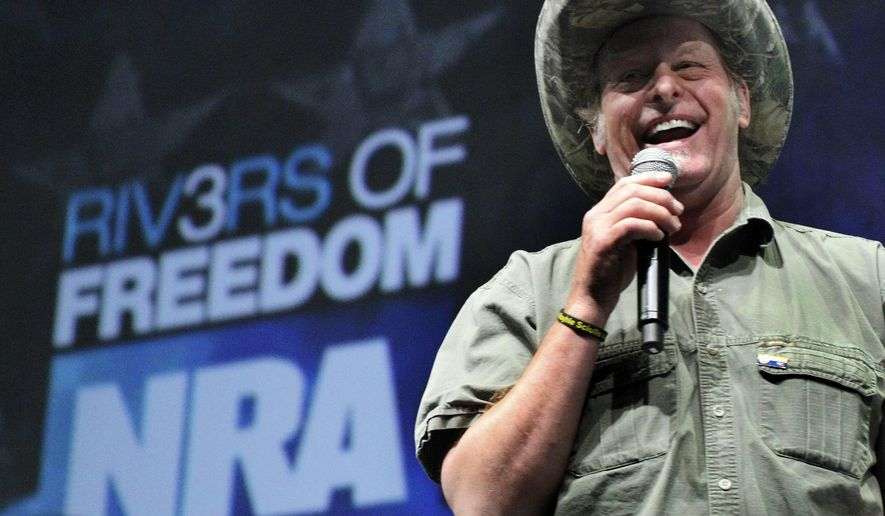 FILE - In this May 1, 2011, file photo, musician and gun rights activist Ted Nugent addresses a seminar at the National Rifle Association's 140th convention in Pittsburgh. The National Rifle Association is gathering for its 148th annual meeting beginning Thursday, April 25, 2019, in Indianapolis. (AP Photo/Gene J. Puskar, File)