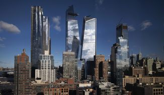 In this Dec. 4, 2018 photo, skyscrapers rise above Hudson Yards in the west side of Manhattan borough of New York. New York City Mayor Bill de Blasio presides over a city that's known for its skyscrapers but he is no fan of the glass towers that have transformed the Manhattan skyline in recent decades. (AP Photo/Mark Lennihan)