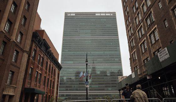 FILE - In this Sept. 18, 2017, file photo, a man talks to a police officer outside the United Nations building in New York. New York City Mayor Bill de Blasio presides over a city that's known for its skyscrapers but he is no fan of the glass towers that have transformed the Manhattan skyline in recent decades. (AP Photo/Andres Kudacki, File)