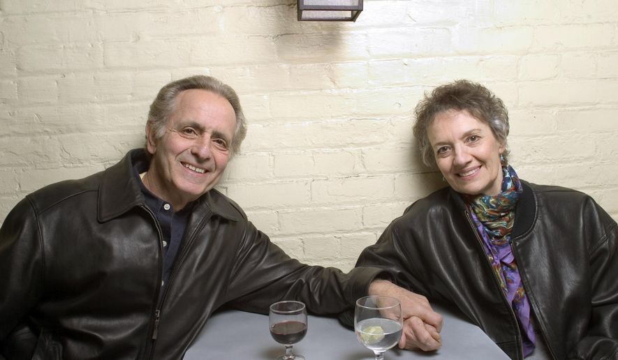 """FILE - In this April 8, 2004 file photo, playwright Mark Medoff, left, and actress Phyllis Frelich pose for a photo in New York. Medoff, who wrote the award-winning play """"Children of a Lesser God,"""" has died in New Mexico at age 79. Medoff's daughter, Jessica Bunchman, confirmed that he died Tuesday, April 23, 2019, in a Las Cruces hospice, surrounded by family. Frelich won a Tony in 1980 for her Broadway portrayal of Sarah Norman, the deaf woman at the heart of the play. (AP Photo/Justin Walters, File)"""