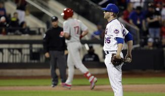 New York Mets relief pitcher Jacob Rhame, right, reacts as Philadelphia Phillies' Rhys Hoskins runs the bases after hitting a two-run home run during the ninth inning of a baseball game, Wednesday, April 24, 2019, in New York. (AP Photo/Frank Franklin II) **FILE**