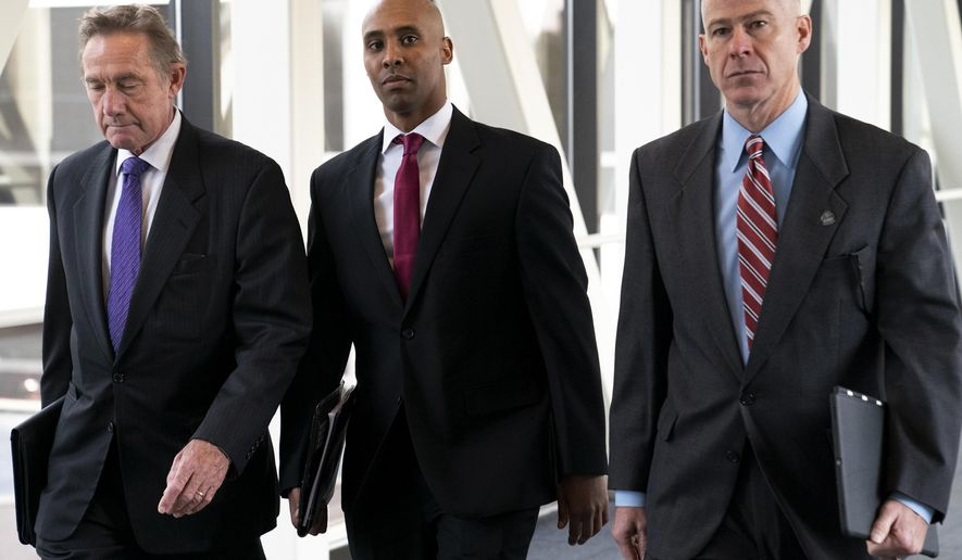 FILE - In this April 1, 2019, file photo, former Minneapolis police officer Mohamed Noor, center, arrives for the first day of jury selection with his attorneys Peter Wold, left, and Thomas Plunkett, at the Hennepin County Government Center in Minneapolis, Minn. Noor is charged in the July 2017 death of Justine Ruszczyk Damond, who was killed after she called 911 to report a possible sexual assault behind her home.(Renee Jones Schneider/Star Tribune via AP, File)