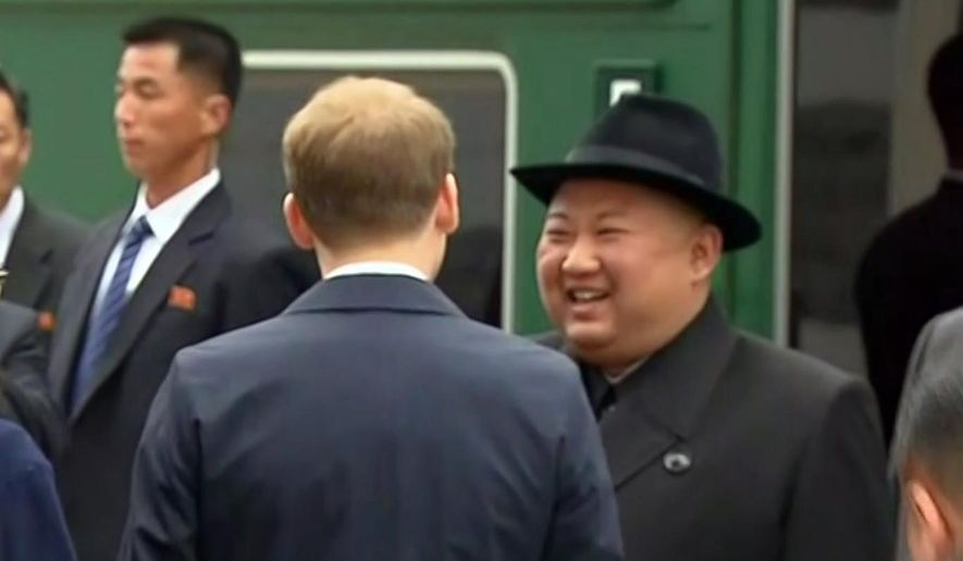 In this image taken from the RU-RTR Russian television, North Korean leader Kim Jong-un smiles as he leaves a train in Vladivostok railway station in Vladivostok, Russia, Wednesday, April 24, 2019. North Korean leader Kim Jong Un arrived in Russia by train on Wednesday, a day before his much-anticipated summit with President Vladimir Putin that comes amid deadlocked diplomacy on his nuclear program. (RU-RTR Russian Television via AP)