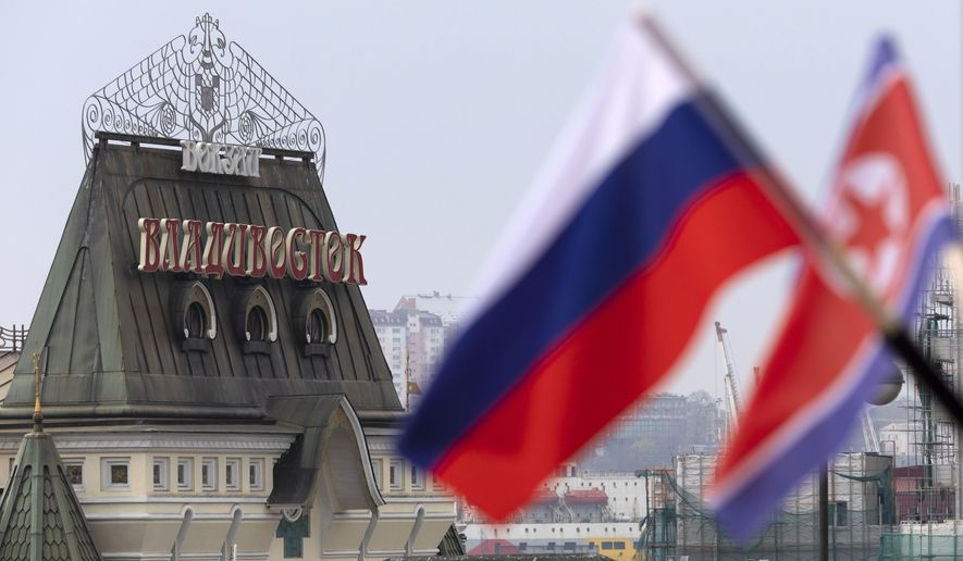 Flags of Russia and North Korea are seen in front of the central railway station in Vladivostok, Russia, Wednesday, April 24, 2019. North Korean leader Kim Jong Un arrived in Russia on Wednesday morning for his much-anticipated summit with Russian President Vladimir Putin in the Pacific port city of Vladivostok. (AP Photo/Alexander Khitrov)