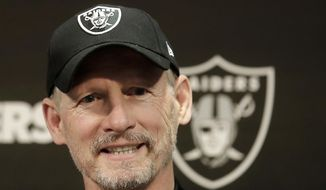 Oakland Raiders general manager Mike Mayock speaks during an NFL football news conference in Alameda, Calif., Thursday, April 11, 2019. (AP Photo/Jeff Chiu)