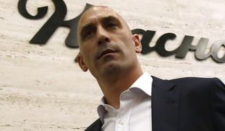 FILE  - In this Wednesday, June 13, 2018 file photo, Spanish football president Luis Rubiales leaves a press conference at the 2018 soccer World Cup in Krasnodar, Russia. The president of the Spanish federation says he is looking into the possibility of playing the Spanish Super Cup in Saudi Arabia beginning next year. (AP Photo/Manu Fernandez, File)