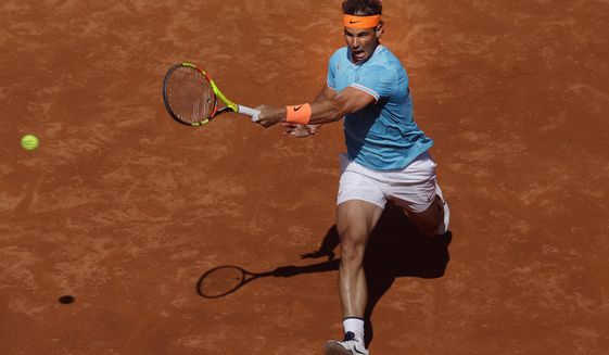 Spain's Rafael Nadal chases down the ball to return against Argentina's Leonardo Mayer during a men's singles match at the Barcelona Open Tennis Tournament in Barcelona, Spain, Wednesday, April 24, 2019. (AP Photo/Manu Fernandez)