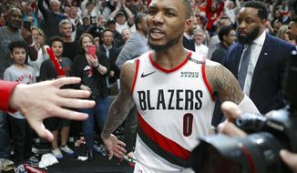 Portland Trail Blazers' Damian Lillard leaves the court after hitting the game-winning three-pointer to beat the Oklahoma City Thunder 118-115 in Game 5 of their best-of-seven first-round playoff series in Portland, Ore., Tuesday, April 23, 2019. Lillard finished with a franchise playoff-record 50 points and Portland eliminated Oklahoma City from the postseason. (Sean Meagher/The Oregonian via AP)