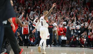 Portland Trail Blazers' Damian Lillard gestures after shooting the game-winning three-pointer to beat the Oklahoma City Thunder 118-115 in Game 5 of their best-of-seven first-round playoff series in Portland, Ore., Tuesday, April 23, 2019. Lillard finished with a franchise playoff-record 50 points and Portland eliminated Oklahoma City from the postseason. (Sean Meagher/The Oregonian via AP)