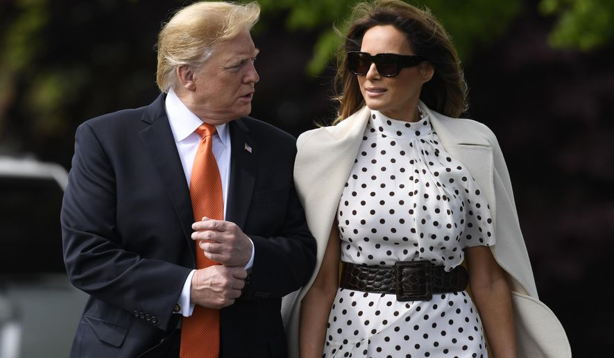 President Donald Trump and first lady Melania Trump walk to Marine One on the South Lawn of the White House in Washington, Wednesday, April 24,2019. The Trumps are traveling to Atlanta to speak at a summit on drug abuse. (AP Photo/Susan Walsh)