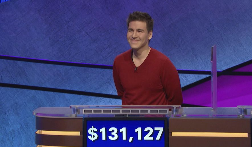 """FILE - This file image made from video and provided by Jeopardy Productions, Inc. shows """"Jeopardy!"""" contestant James Holzhauer on an episode that aired on April 17, 2019. On his 14th appearance Tuesday, April 23, 2019, Holzhauer eclipsed the $1 million mark in winnings. (Jeopardy Productions, Inc. via AP)"""